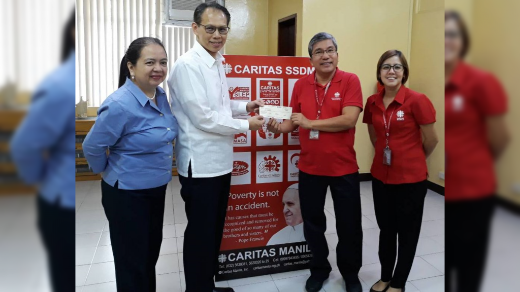 Supporting Caritas Manila with Rev. Father Anton C. T. Pascual and Kiel Fernandez and presented by FMAP Treasurer Smith L. Chua and FMAP Exe. Director Maria Luisa T. Alcoseba